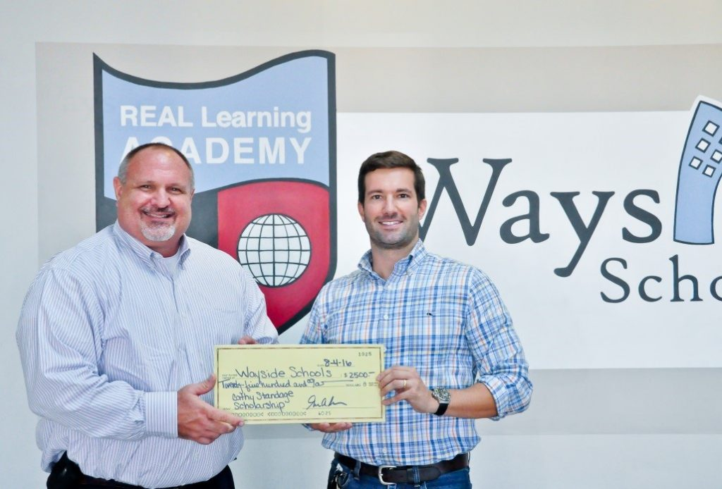 George Ross of Knight Office Solutions presenting a scholarship check to Wayside Schools' Riley